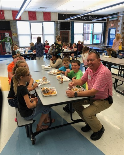 Mr. Chris Edwards grabs a bite with some of our students!