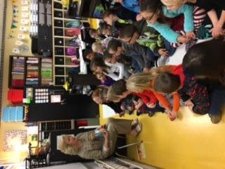 Mrs. Fowler reads to students